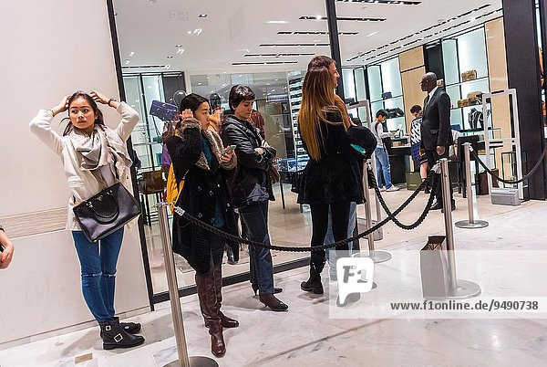 Paris  France  Chinese Tourists Shopping inside French Department Store  Printemps  Queuing