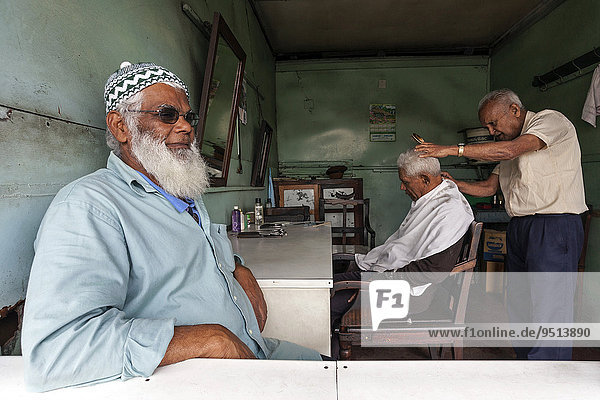 Local men at the hairdresser's  Mahebourg  Mauritius  Africa