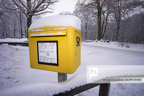 A Deutsche Post mail box in the snow  Germany  Europe
