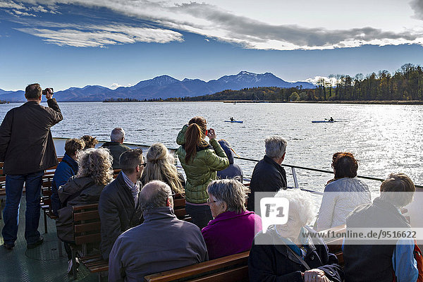 Tourists sightseeing on a Chiemsee ferry  Upper Bavaria  Bavaria  Germany  Europe