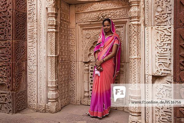 Young Indian woman posing in the Qutub Minar Complex or Qutb Complex  UNESCO World Heritage Site  Delhi  India  Asia