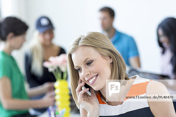 Smiling woman talking via cell phone