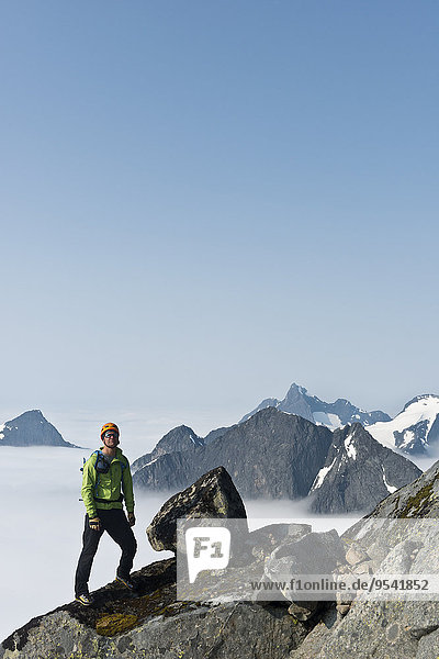 Hiker standing on top of mountain