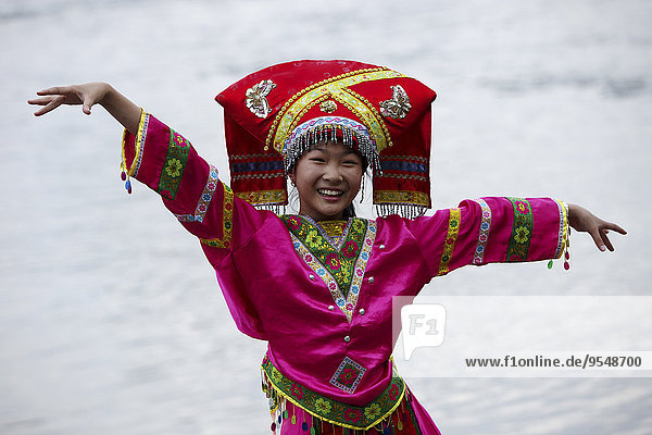China  Guilin  Li river  woman wearing a traditional costume