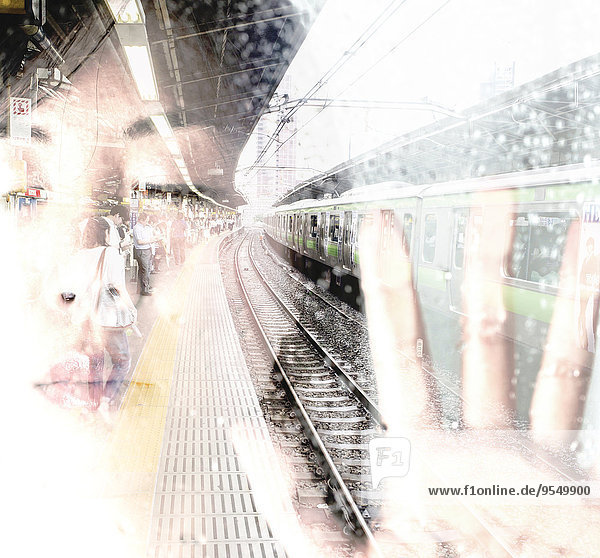 Face of Asian woman with closed eyes and japanese train station  double exposure