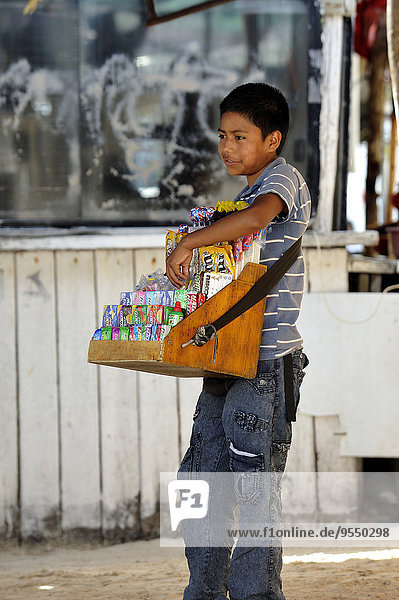 Mexico  Cancun  boy selling sweets from vendor's tray