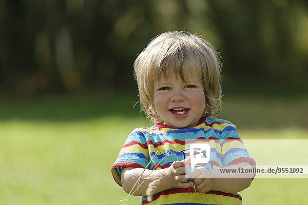 France  Britanny  Sainte-Anne-la-Palud  portrait of smiling little boy