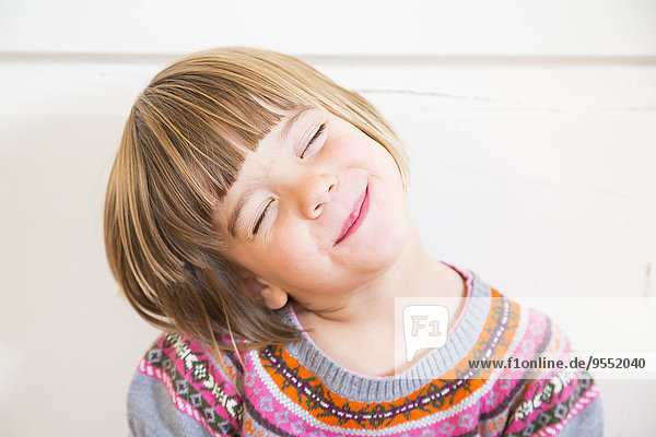 Portrait of cute little girl with closed eyes