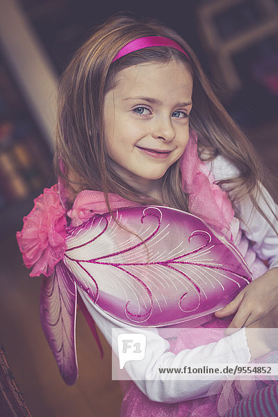 Portrait of smiling little girl masquerade as a fairy