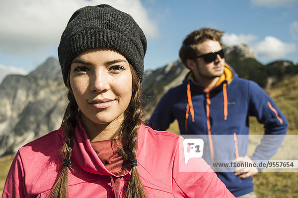 Austria  Tyrol  Tannheimer Tal  portrait of smiling young woman in mountains