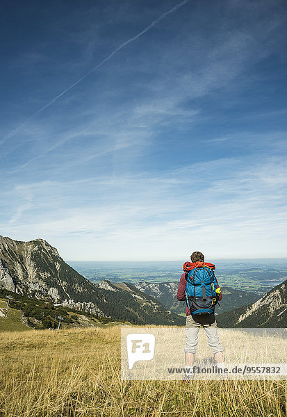 Austria  Tyrol  Tannheimer Tal  young hiker looking at view