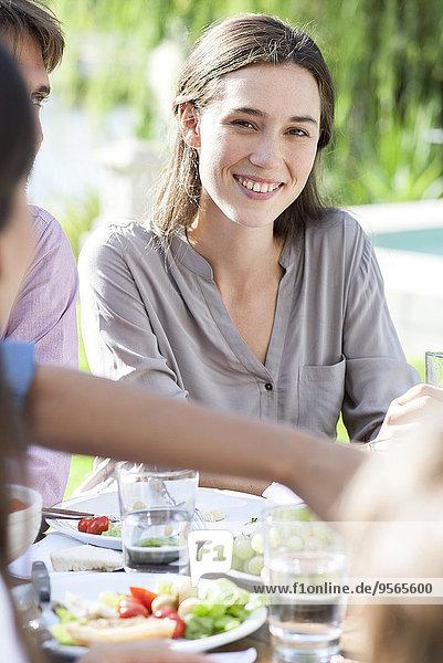 Young woman enjoying picnic outdoors