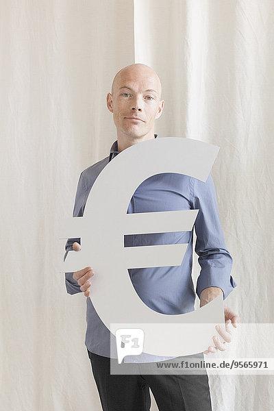 Portrait,Geschäftsmann,Symbol,halten,Büro,Hoffnung,Euro