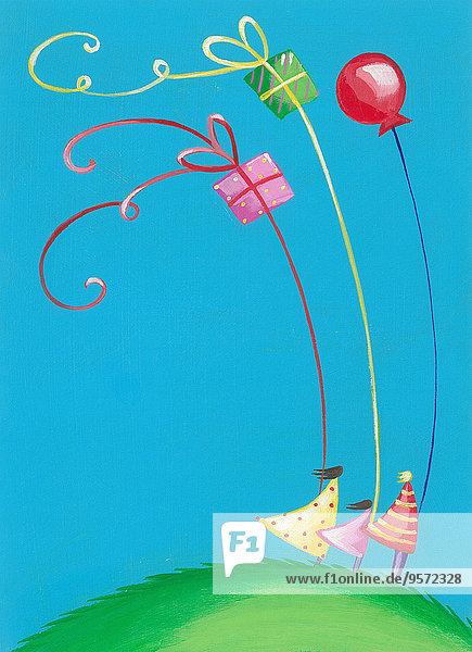 Familie mit Geschenk-Luftballons