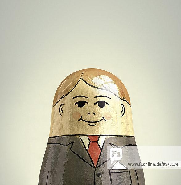 Lächelnder Geschäftsmann als Matroschka-Puppen