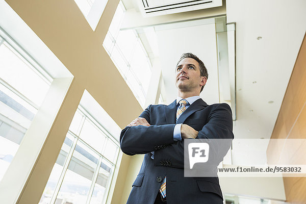 Low angle view of Caucasian businessman standing in office