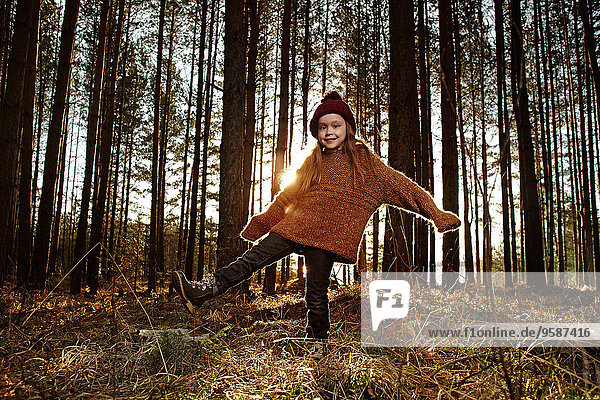 Caucasian girl standing in forest