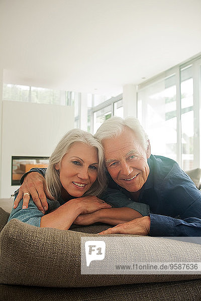 Portrait of smiling senior couple spending time together at home