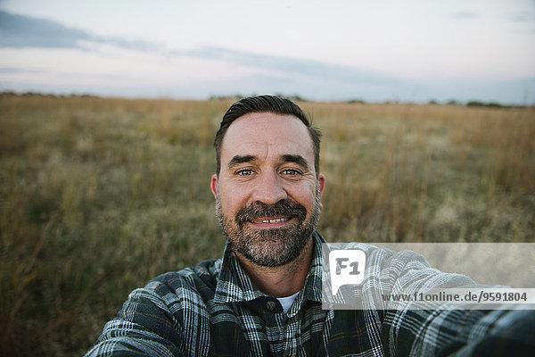 Self portrait of smiling farmer in field  Plattsburg  Missouri  USA