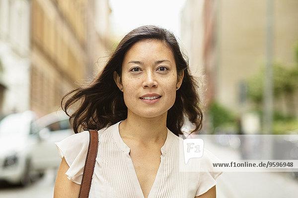 Portrait of woman on city street