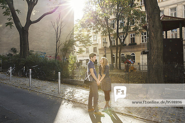 Young couple face to face on suburban street