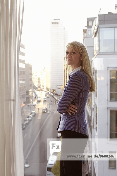 Businesswoman in office looking at camera