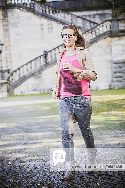 Young woman running outdoors  Munich  Bavaria  Germany