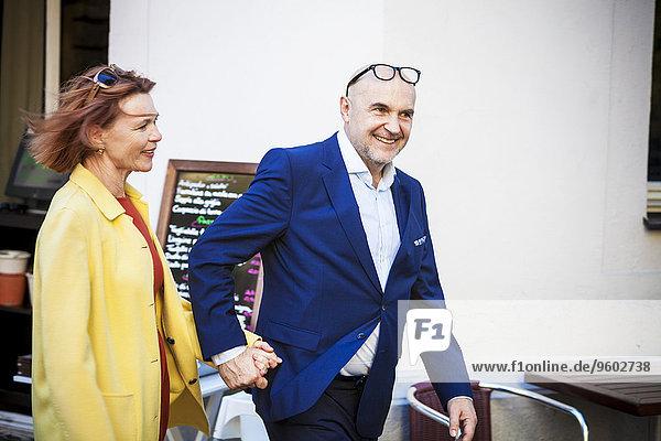 Senior couple holding hands  Munich  Bavaria  Germany