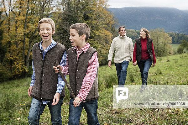 Family Walking In Field  Bavaria  Germany  Europe