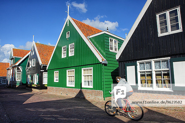 Netherlands  Marken  houses and person on bicycle