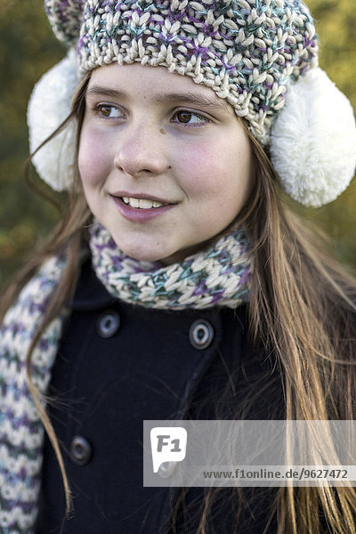 Portrait of girl wearing ear muff and wool cap