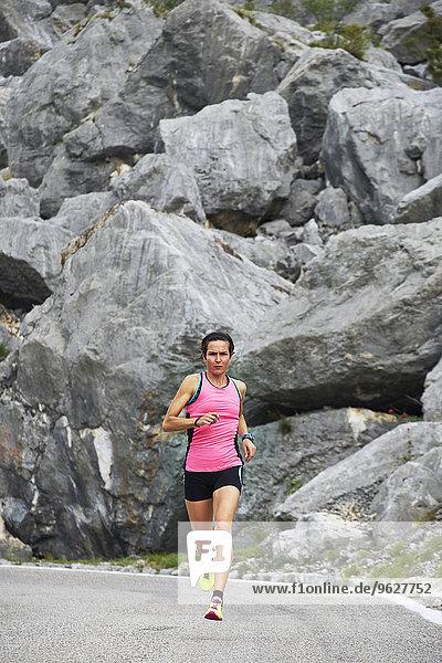 Italy  Trentino  woman running on road near Lake Garda