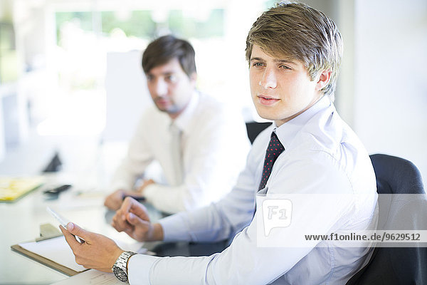 Young man in a business meeting in conference room