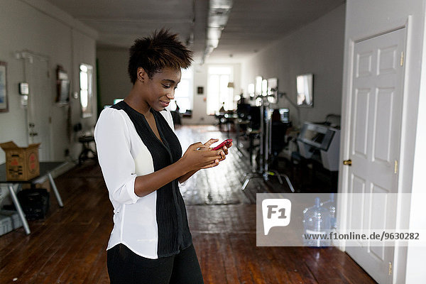 Woman using smartphone  home office