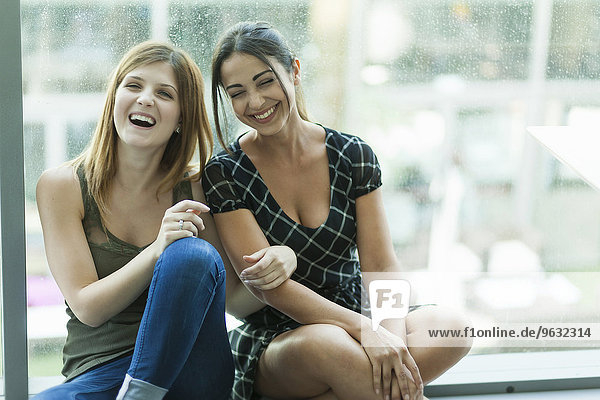 Women sitting together laughing