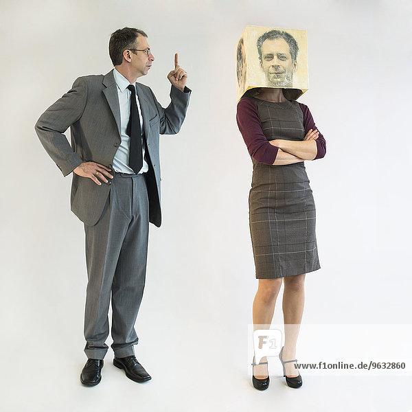 Businessman scolding businesswoman wearing mask