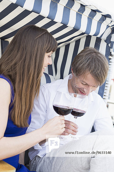Couple toasting wine glasses  smiling