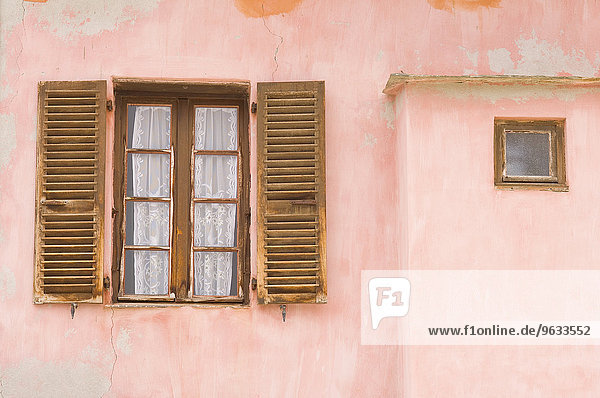 Window pink building facade Saint Florent Corsica