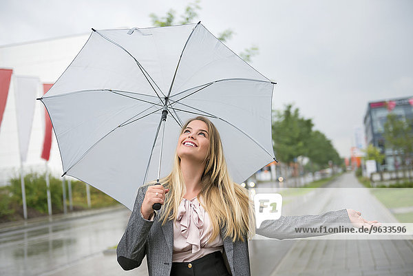Woman anticipation storm umbrella protection