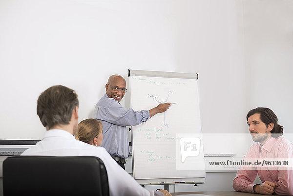 Multi-Ethnic Group men woman meeting office