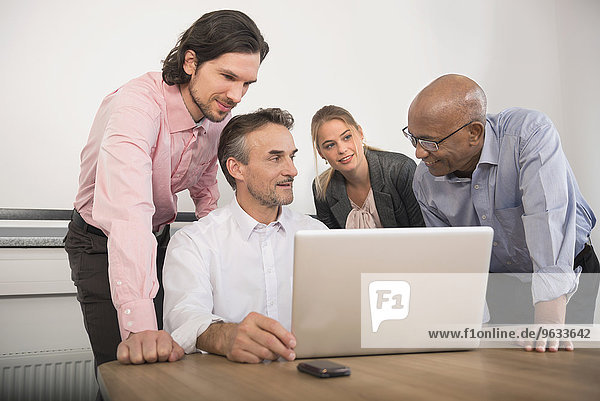 Four business people meeting Brainstorming office