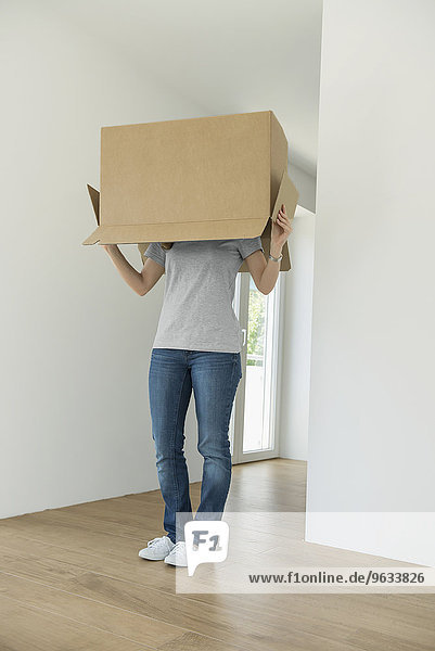 Empty room new home moving in woman