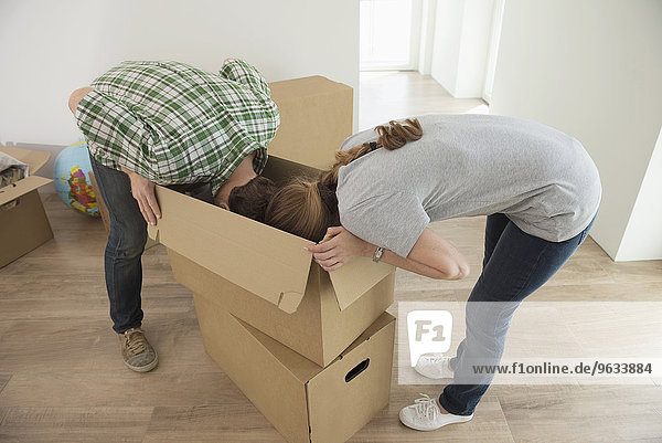 Couple looking searching inside packing box