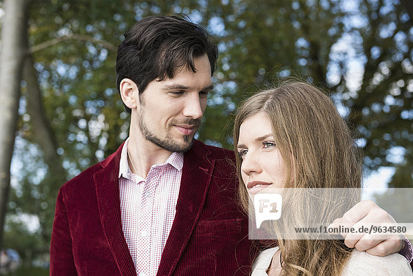 Portrait attractive young couple outdoors