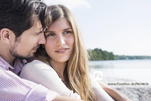 Portrait loving young couple lake romantic