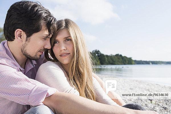 Lake beach young romantic couple portrait