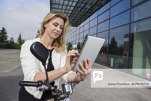 Businesswoman electric scooter tablet computer