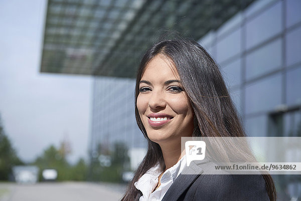 Young happy dark haired businesswoman portrait