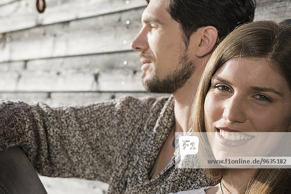 Close up portrait couple relaxing wooden wall