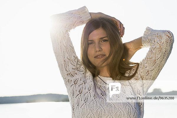 Portrait pretty young woman sunset